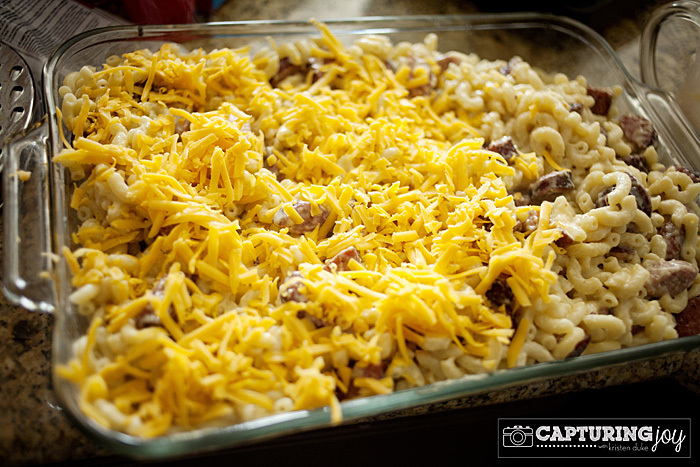 sausage mac and cheese topped with shredded cheese