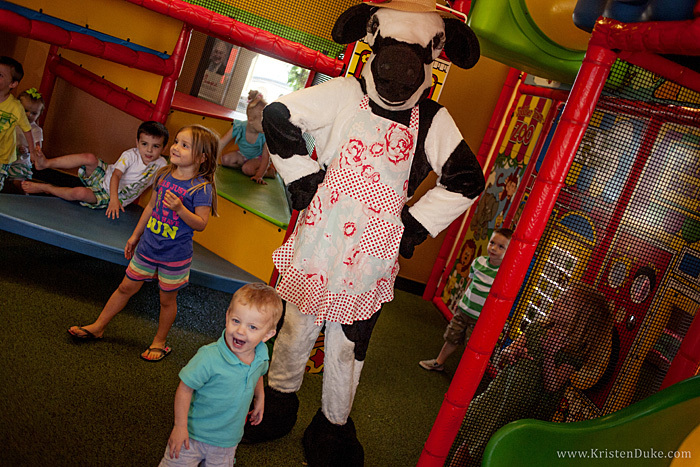 Chick Fil A cow playing with kids