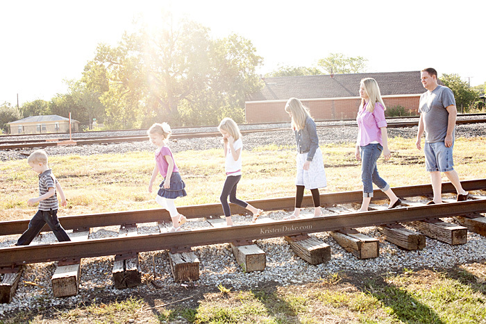 family on train tracks