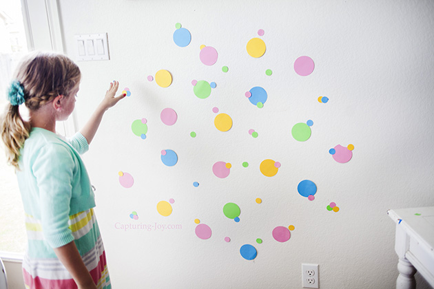 taping dots to the wall