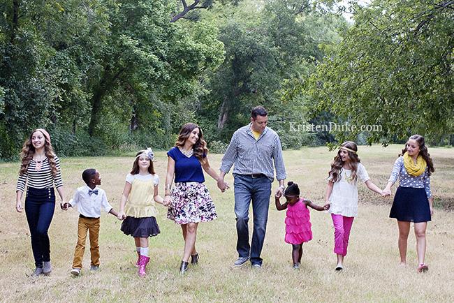 family-walking-in-field-KristenDuke