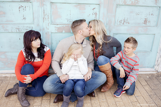 parents kissing kids grossed out picture