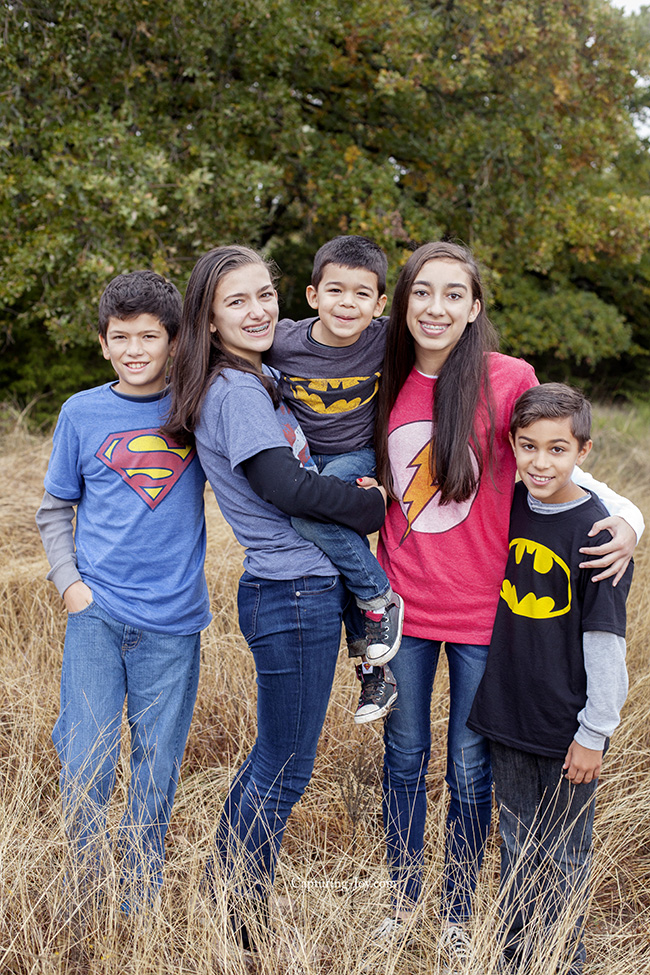 cousins in superhero shirts