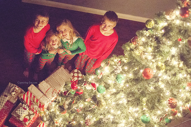 kids by christmas tree