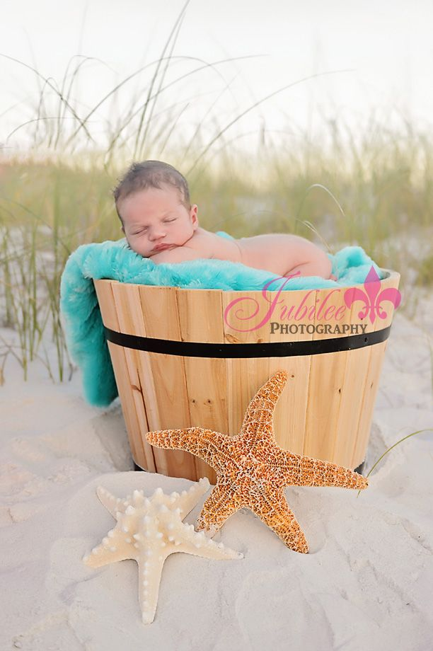 newborn pictures on the beach