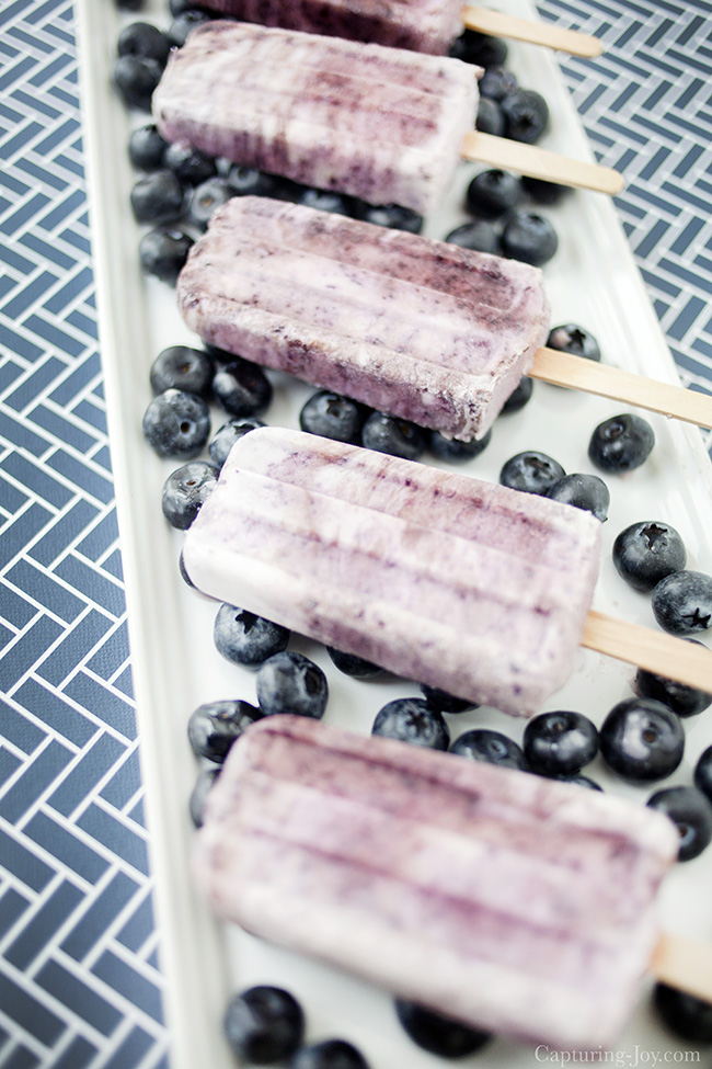 Blueberry Coconut protein popsicles, a delicious frozen summer treat recipe.