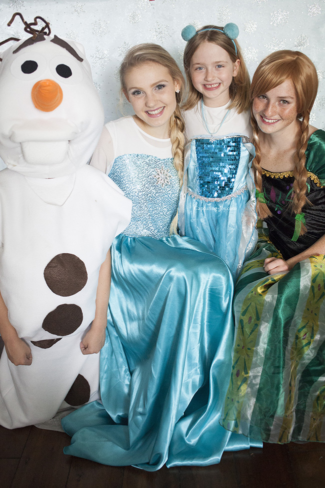 Olaf and Disney Frozen Princesses at party