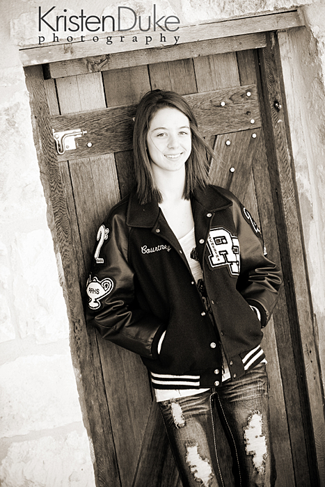 letter jacket in senior pictures