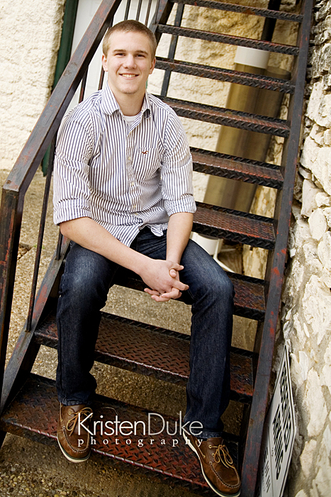 senior boy posing on stairs