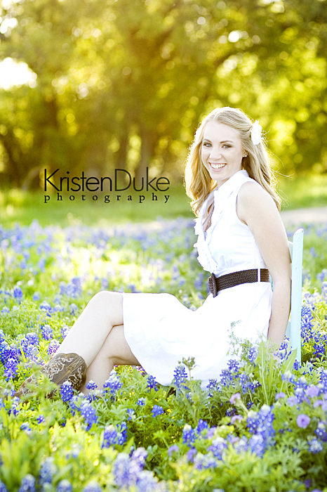 senior portraits in field of flowers
