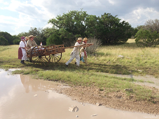 pushing handcart around the mud