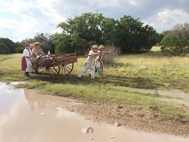 pushing handcart around the mud