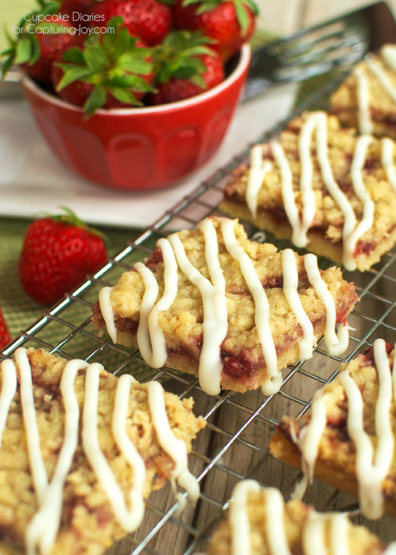 Strawberry Crumb Bars - Crispy cookie crust with a sweet strawberry layer, buttery crumble, and white chocolate glaze. A perfect treat for summer!