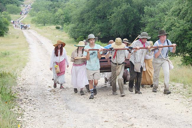 walking up the muddy hill on pioneer trek