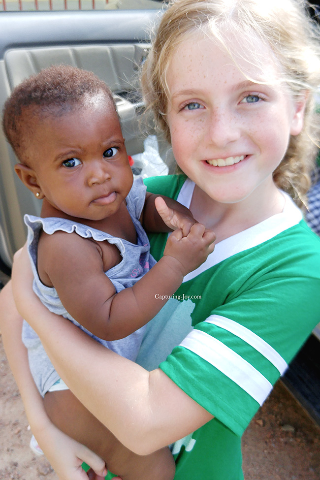 Cuddling baby in Ghana