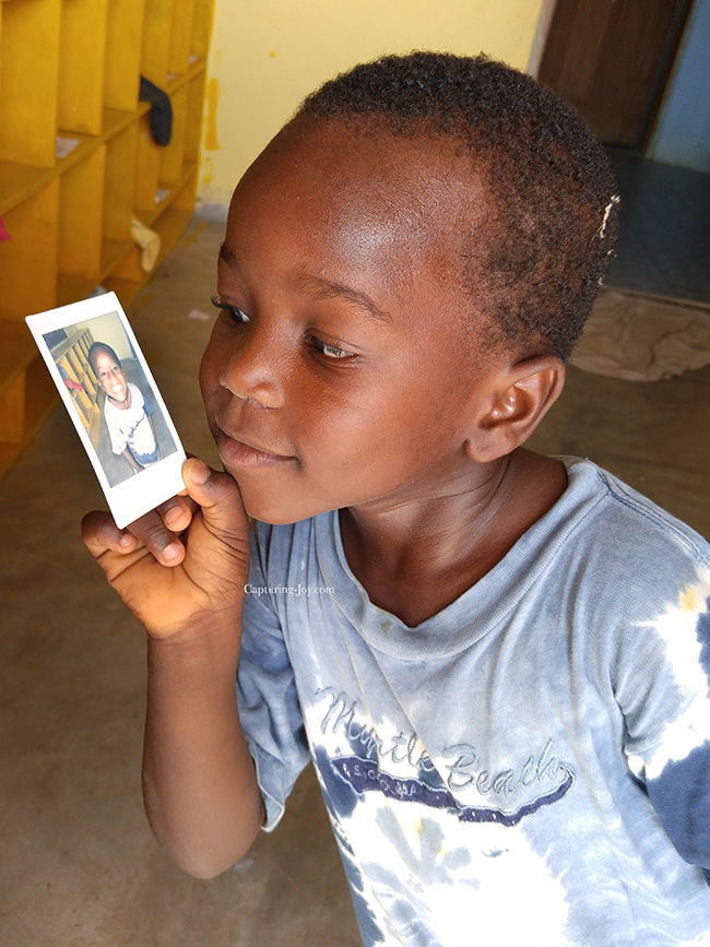 Ghana child with polaroid instax picture