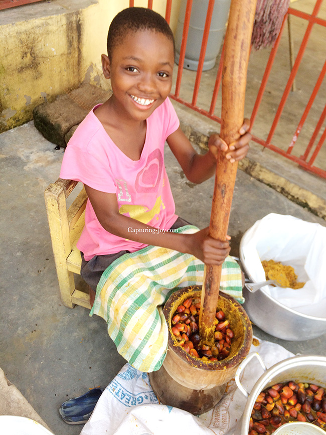 Ghanaian Girl making Fufu for dinner