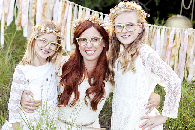 floral crowns and glitter glasses