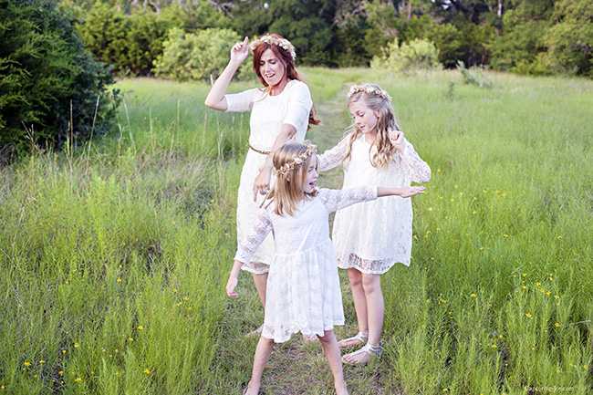 mother daughter dancing in the wildflower field