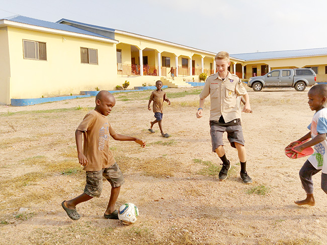 playing soccer with Ghanaian children