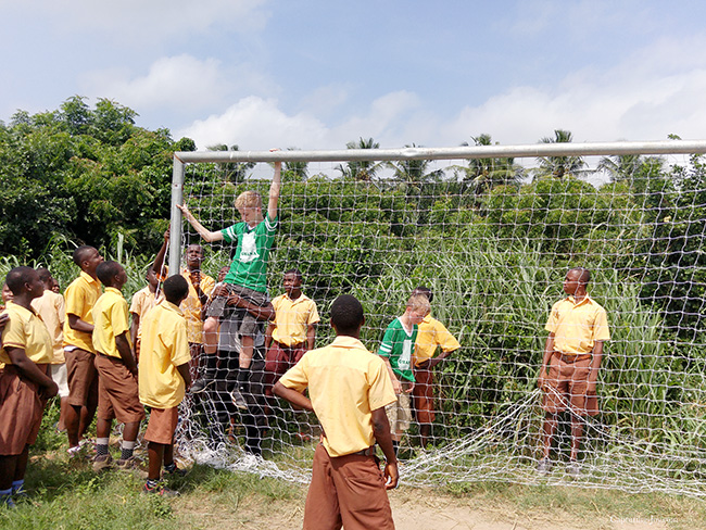 Hanging soccer nets on goal