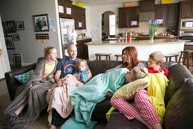 family having fun at home in pajamas