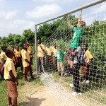 hanging soccer net in Ghana for Eagle project