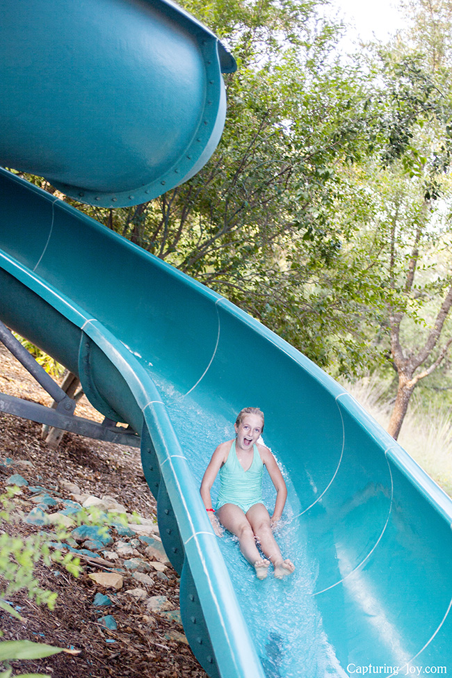 kid racing down a waterslide