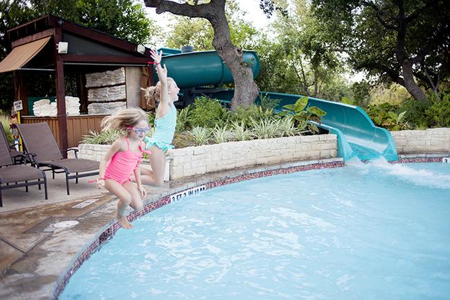 kids jumping into pool at Hyatt Wild Oak Ranch