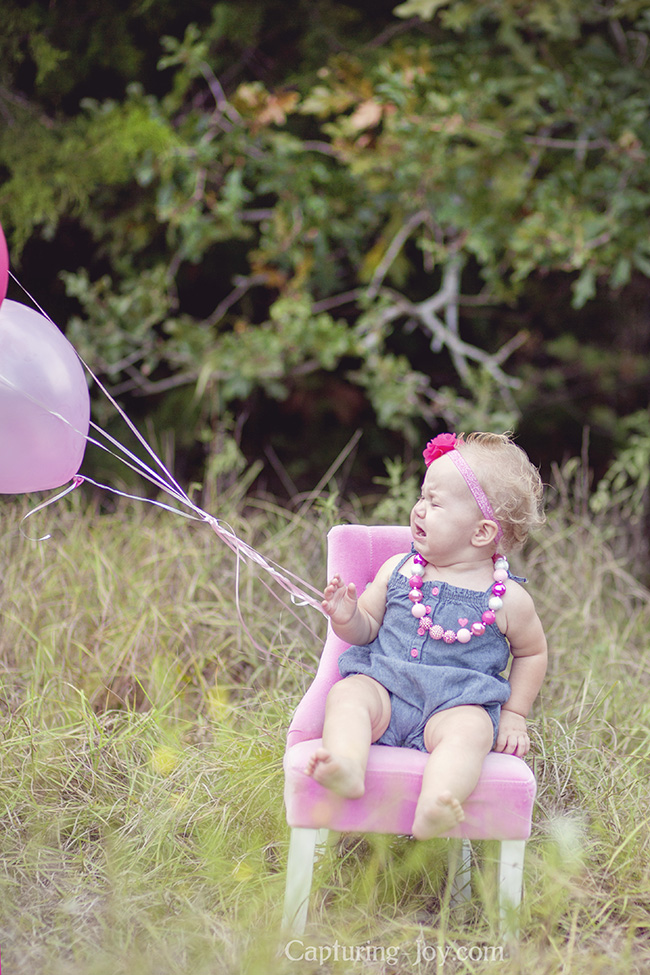balloons flying away in baby photo session
