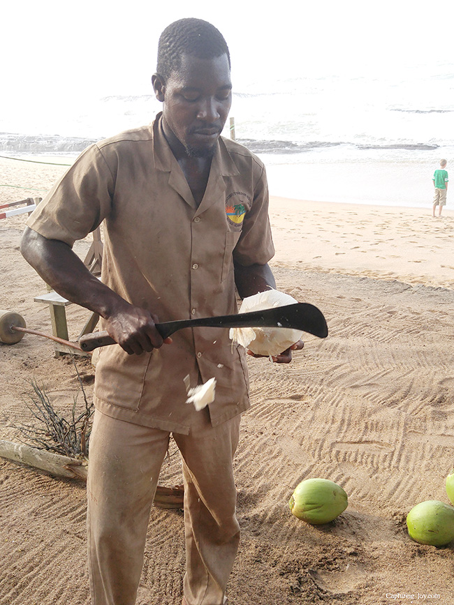 chopping fresh coconut