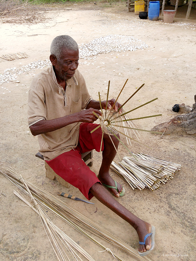 man weaving basket in Ghana
