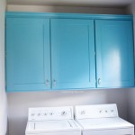 Blue custom laundry room cabinets