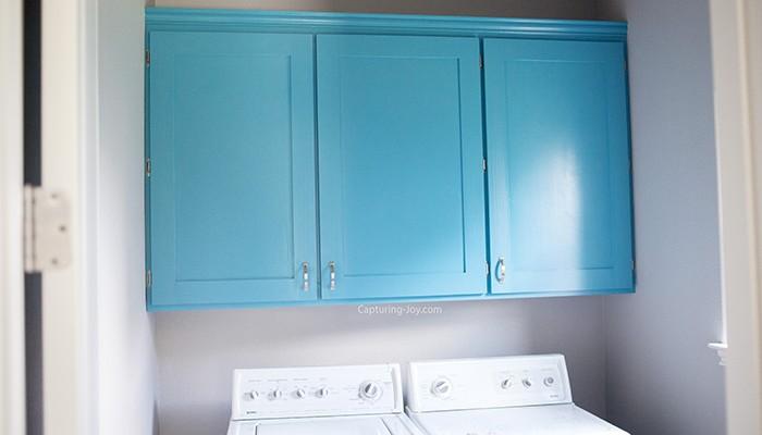 Blue custom laundry room cabinets