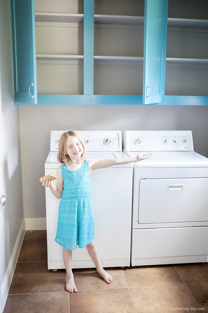 Custom Laundry room cabinets with turquoise paint
