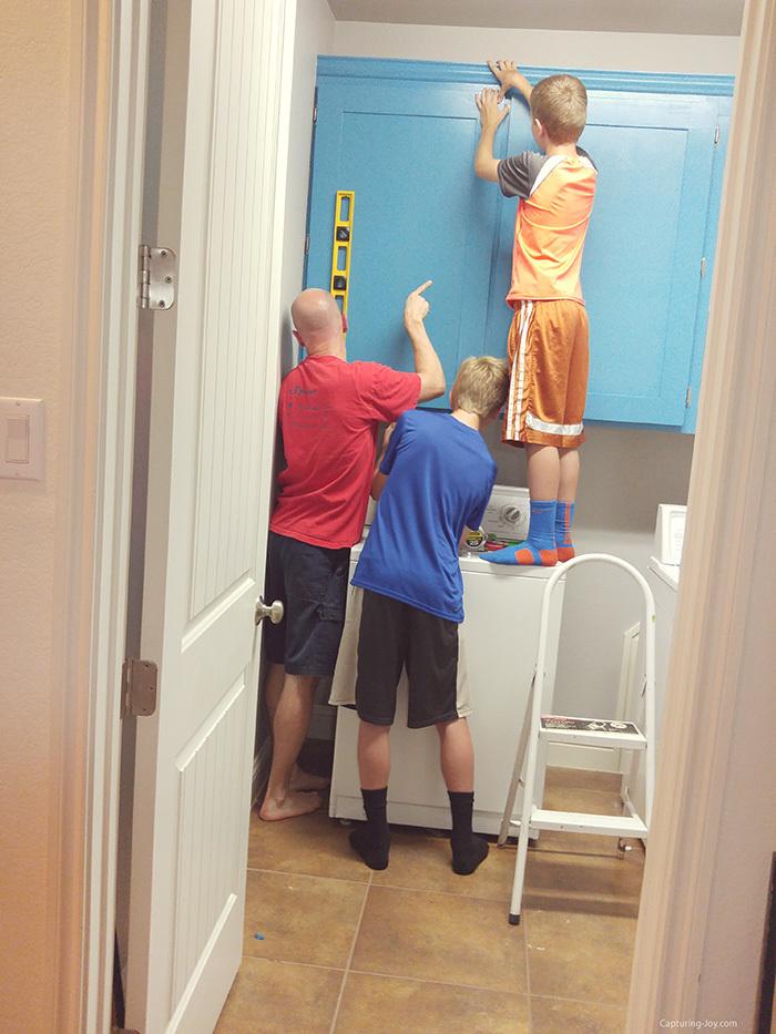 Hanging custom cabinet doors in laundry room
