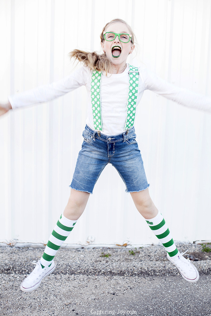st patricks day clothes: shamrock suspenders, green glitter lipstick, green striped socks