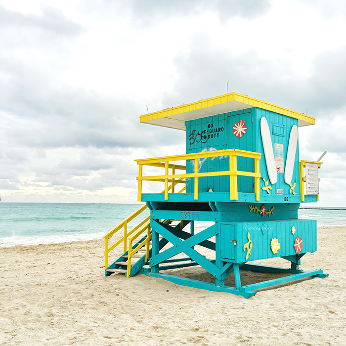 turquoise and yellow lifeguard stand south beach Miami