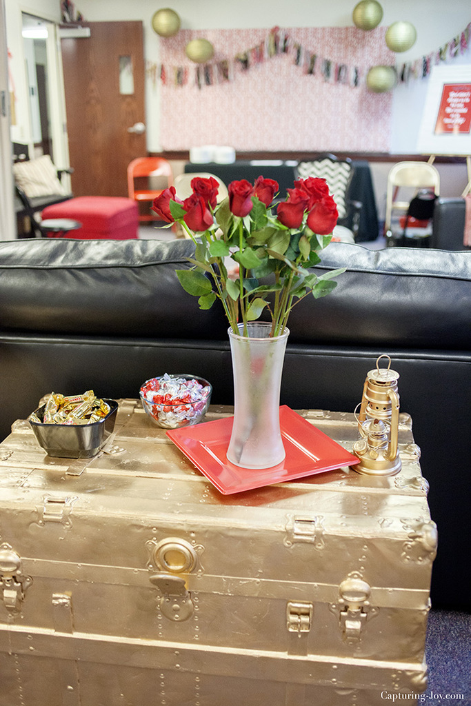 gold painted trunk and red roses
