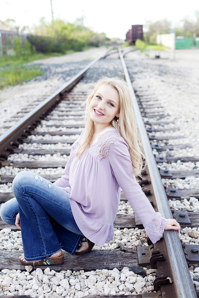 seniors portraits on train tracks