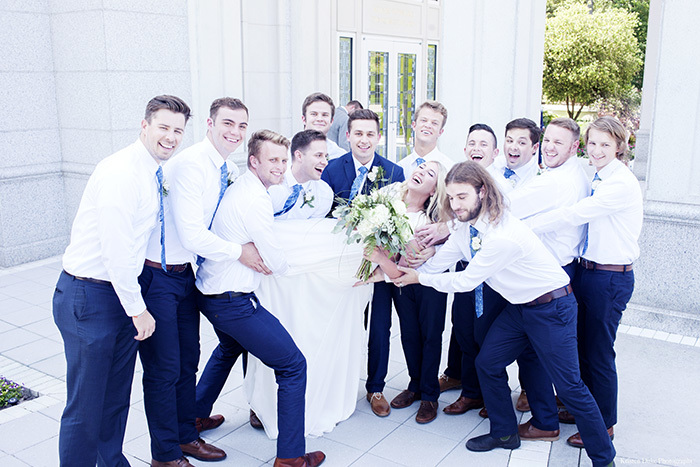 Bride lifted by Groomsmen at Houston LDS Temple Wedding. Click to see lots more!