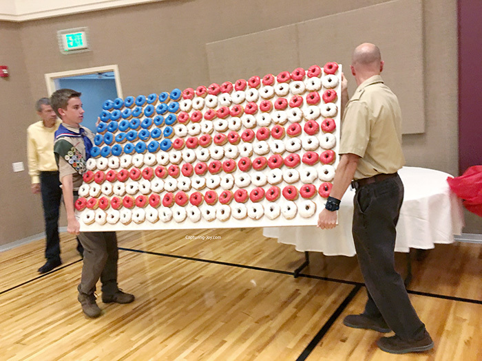 carrying American Flag Doughnut wall