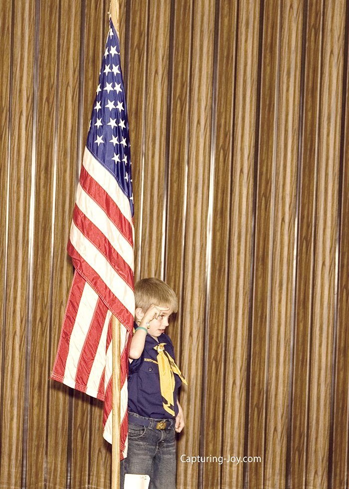 cub scout saluting the American flag