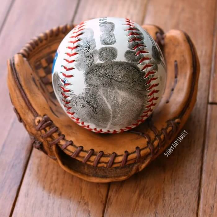 Does your dad love baseball? This handprint baseball gift idea is perfect for Father's Day.