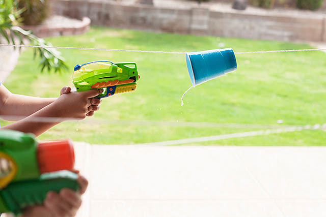 Fun camping activity. Water gun races!