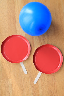 Make these easy tennis paddles to play balloon tennis.