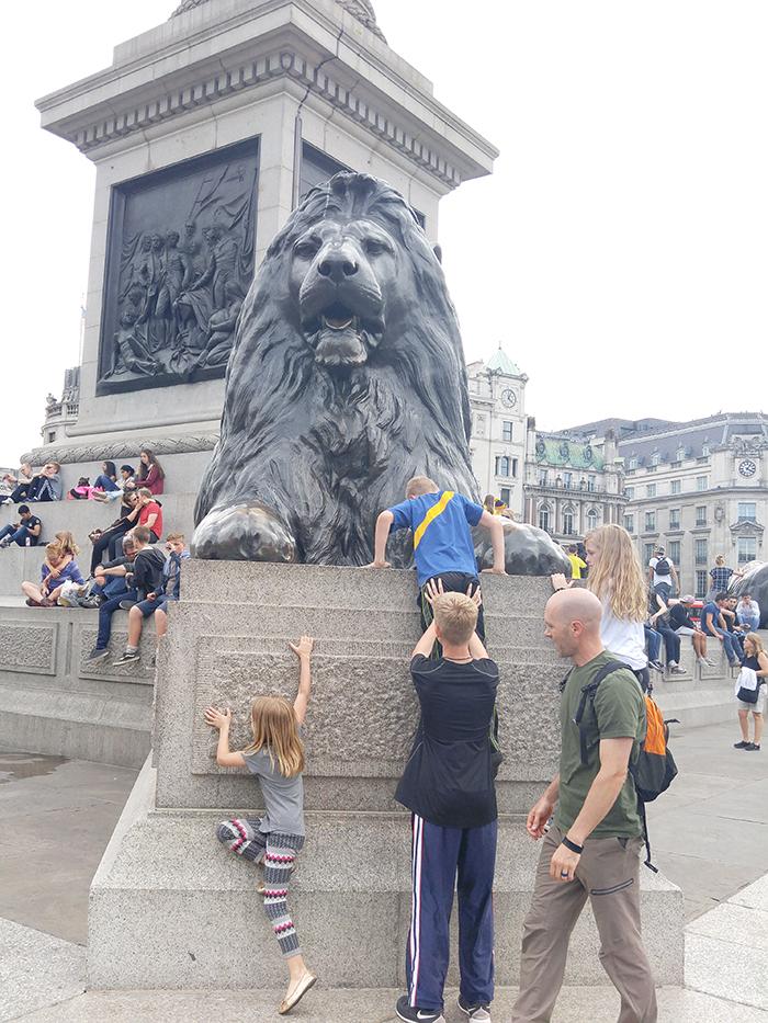 climbing the Lion at Trafalagar Square