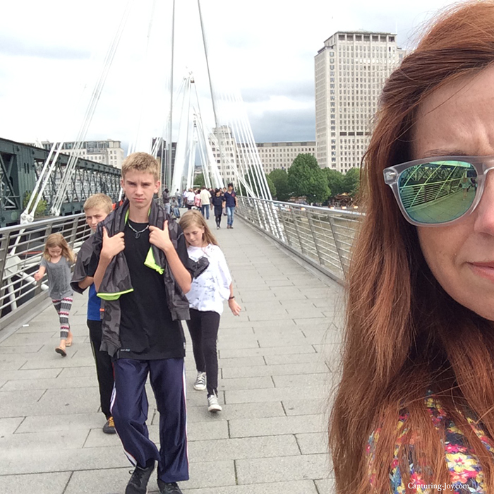 walking across bridge in London