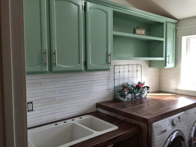 Painted laundry room cabinets.