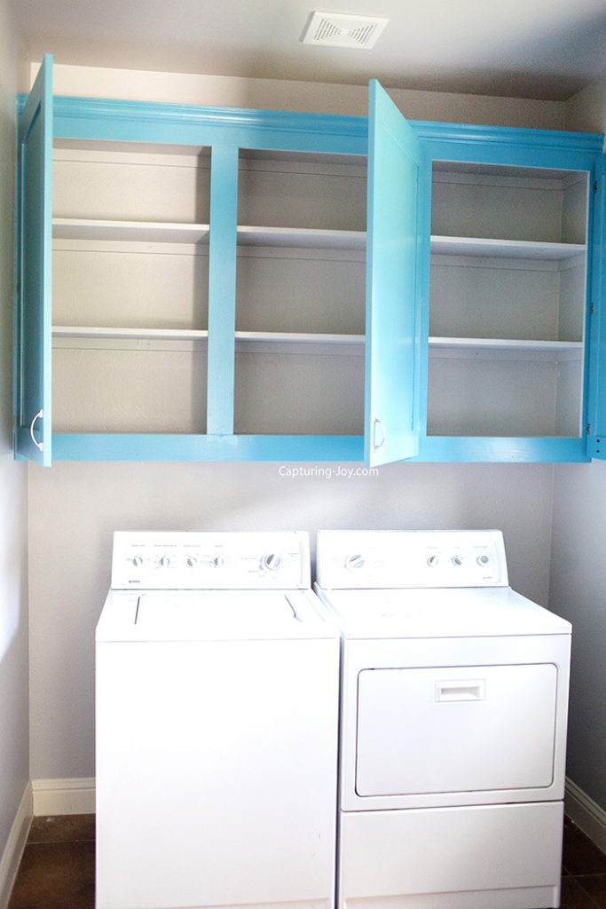 Turquoise laundry room custom cabinets.